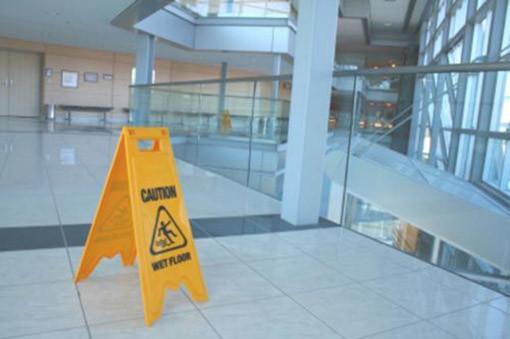 Gebäudereinigung Achtung Schild von Reinigungsfirma